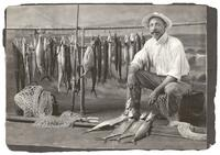 Studio portrait of Herbert M. Greene with fish