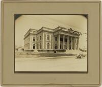 Scottish Rite Cathedral (Dallas, Tex.): exterior view of front entrace with car, corner perspective