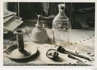 Close shot of various small household items grouped on a table